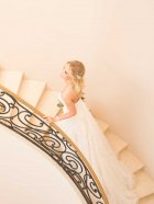 Stella York 6680 wedding dress on the stairs